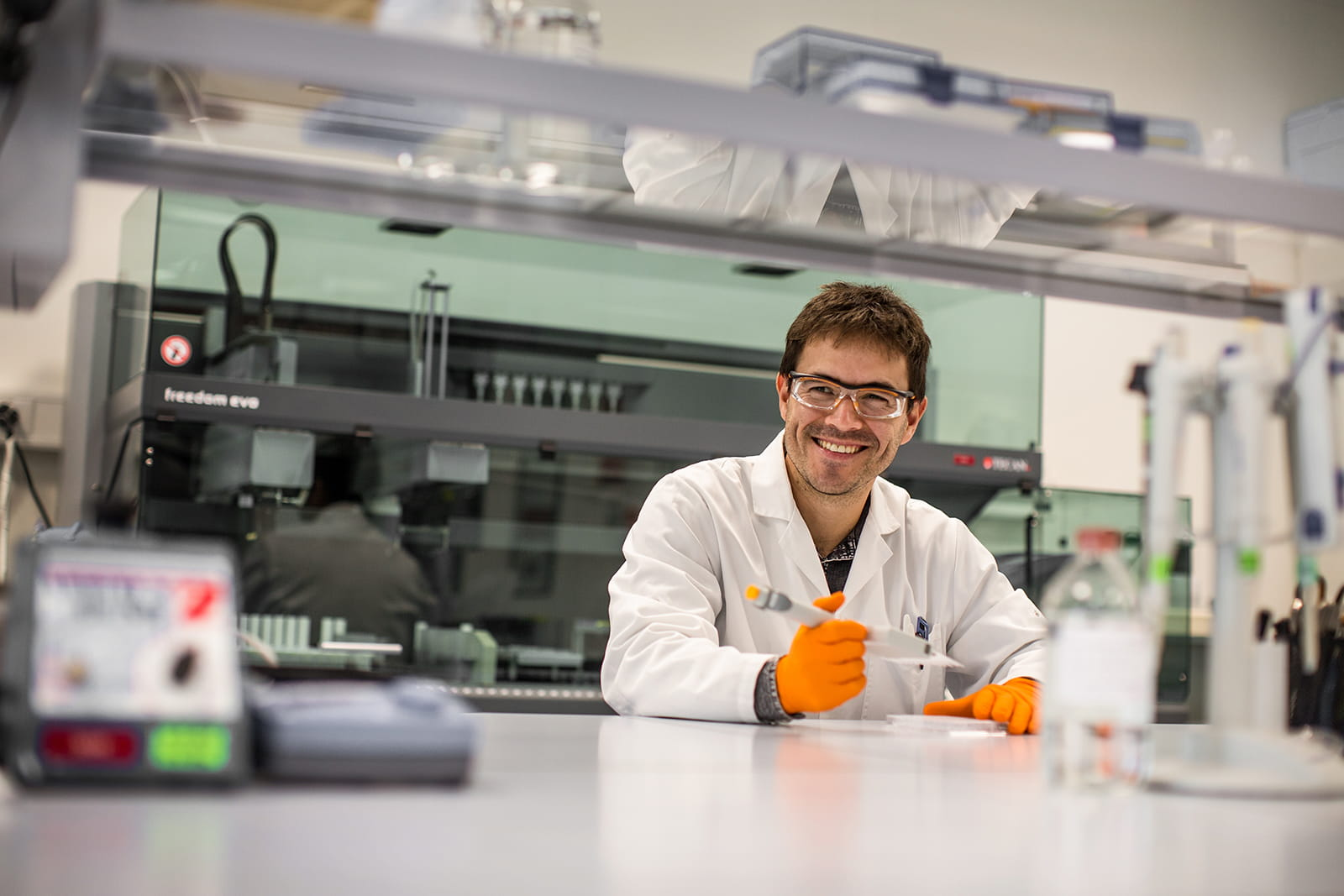 Researcher smiling